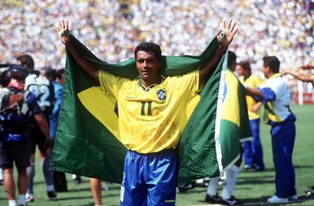 1994 World Cup Final. Pasadena, USA. 17th July, 1994. Brazil 0 v Italy 0. (Brazil won 3-2 on penalties). Brazilian star Romario drapes himself in his country's flag after Brazil won the World Cup by beating Italy on penalties.